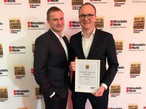 """Denis Trost und Marc Fritzen nehmen die Auszeichnung """"Best of Consulting Mittelstand 2019"""" entgegen."""